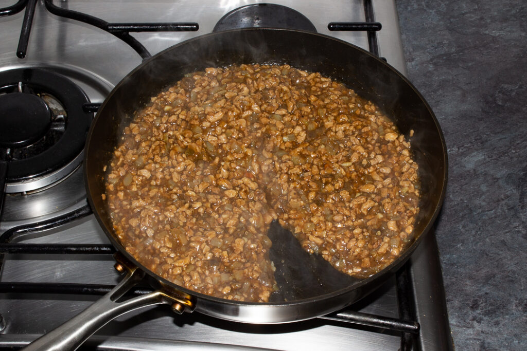 Cooked vegetarian mince and onion pie filling in a frying pan