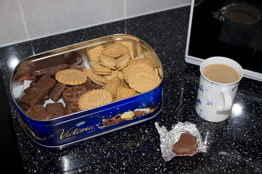 A tin of biscuits and a cup of tea on Gran's kitchen worktop
