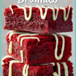 Red velvet brownies drizzled with white chocolate in a stack of 3 against a light neutral backdrop.