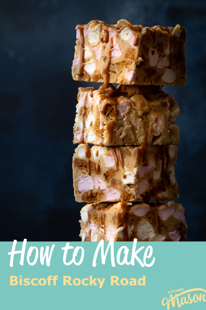 A close up front view of a stack of 4 Biscoff rocky road bars that have been drizzled in more Biscoff spread and stacked up to the side. Set against a blue backdrop. A text overlay says 'How to make Biscoff rocky road'.